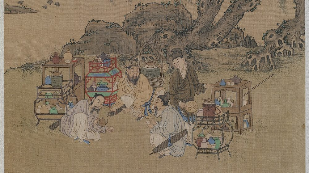 image of people drinking tea under a willow tree