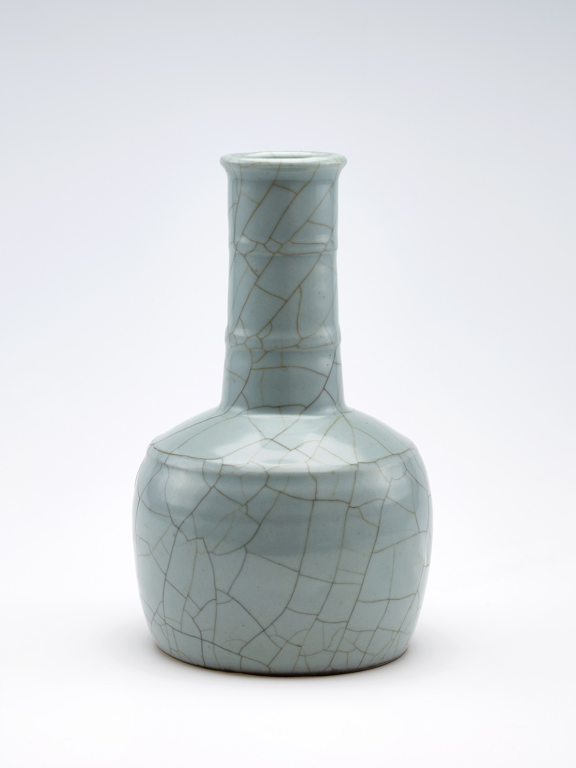 tall ceramic green vessel with a long neck