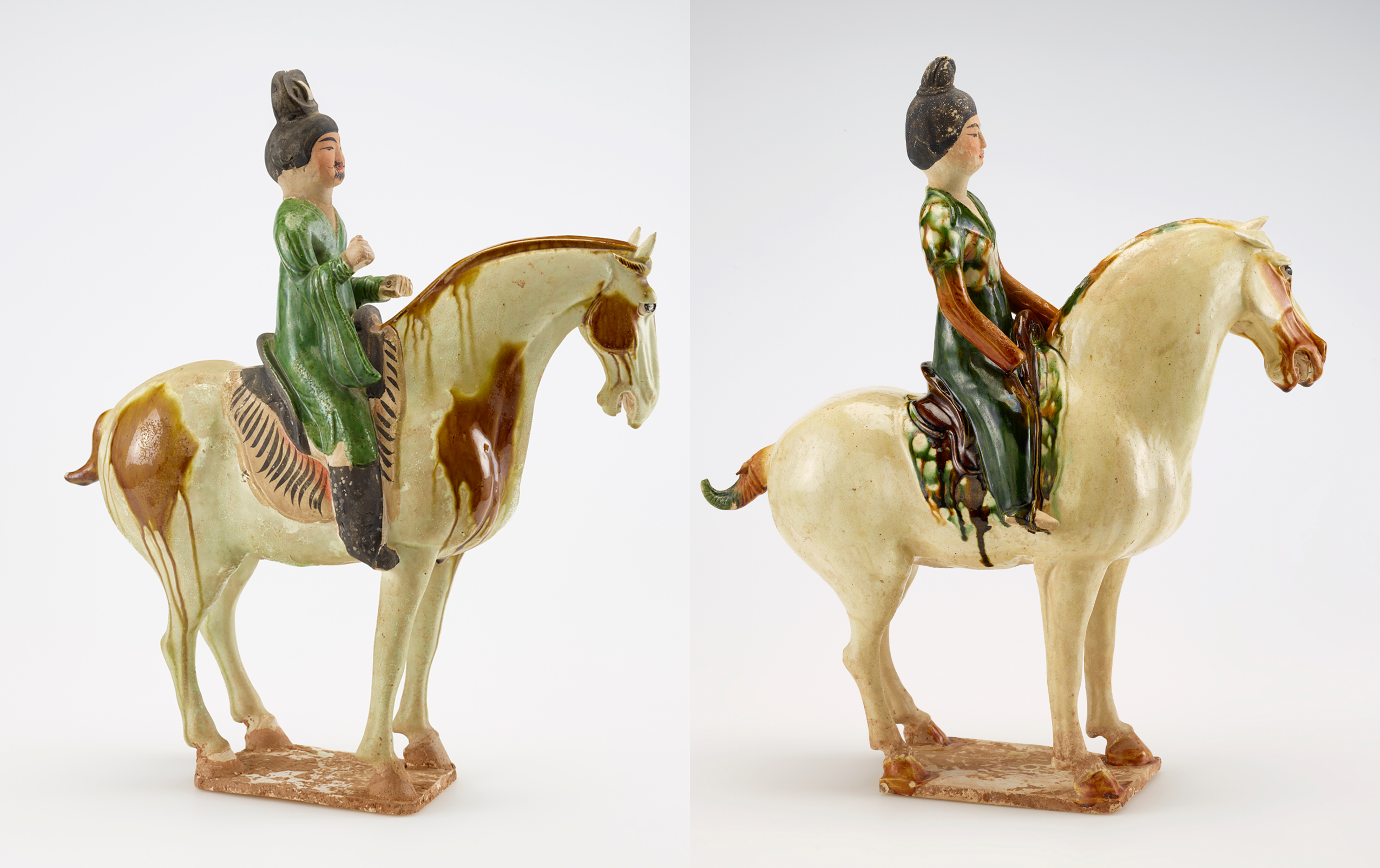 statues of a man and a woman on horseback