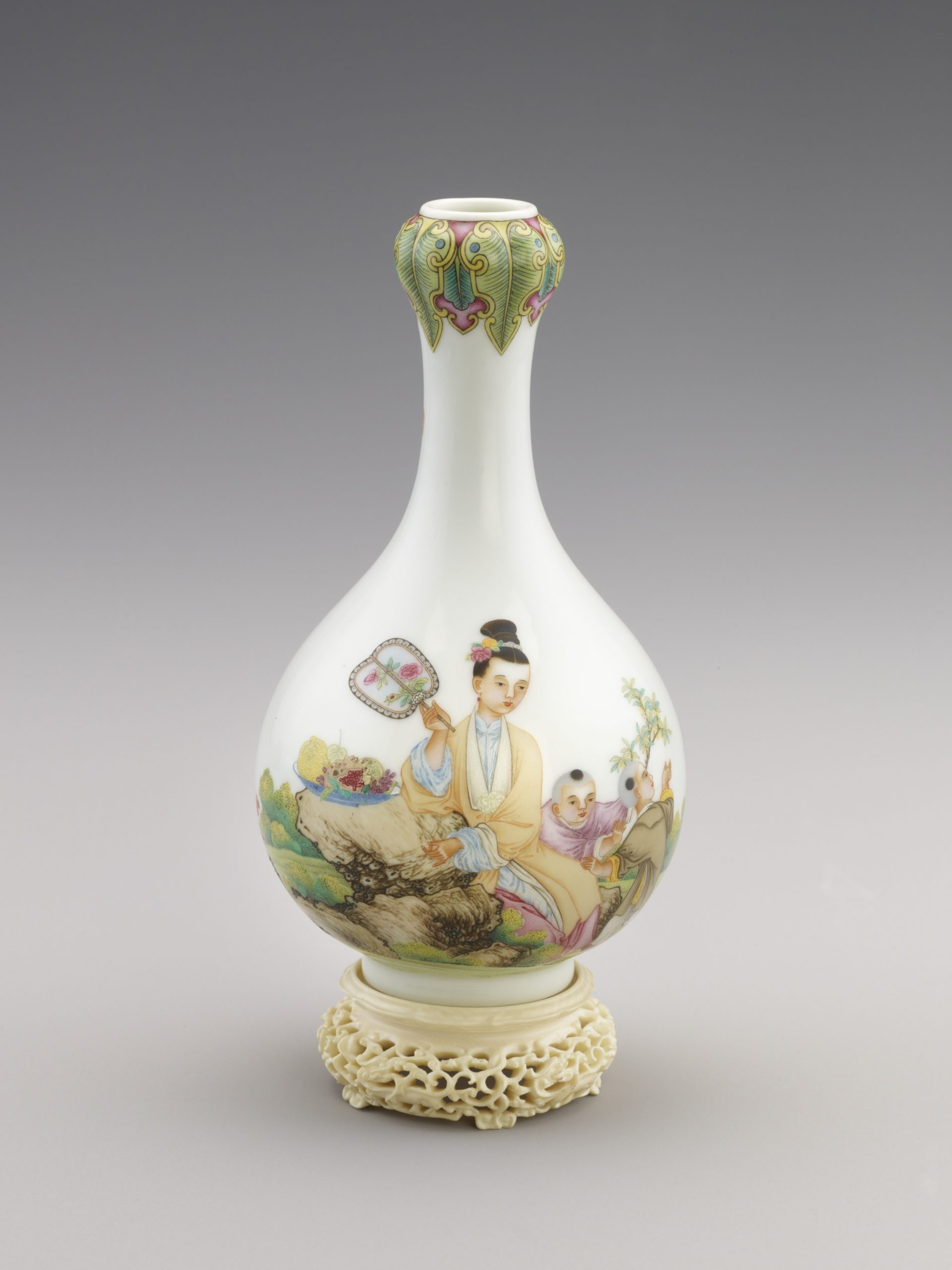 white vase with colorful illustrations and a thin neck