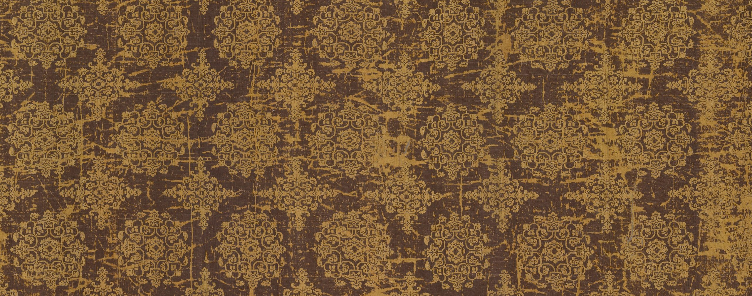 close up detail of gold and red patterned fabric